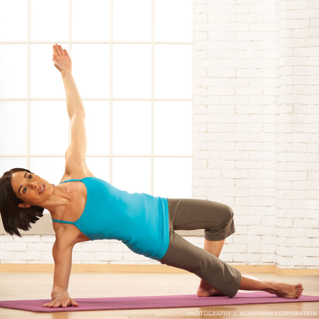 Woman performing a pilates stretch