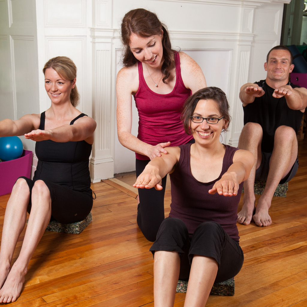 Image of Kelly instructing a clinical Pilates class